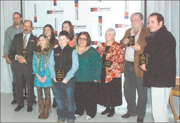 Lindsey Vaculinl/THE CAMERON HERALD The Cameron Chamber of Commerce handed out several awards during its banquet on Feb. 19. At left, Old Town Cameron and Railroad Museum and director Jamie Larson were honored as Organization of the Year. At right, those